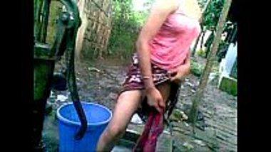 Sexy village girl having an open bath