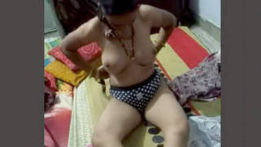 Aunty changing clothes and hubby recording