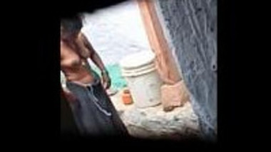 Indian village bhabhi nude during bath and recording by hidden cam