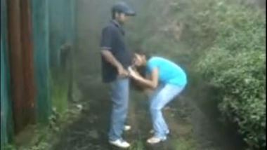 Indian girl sucking and fucking outdoors in rain