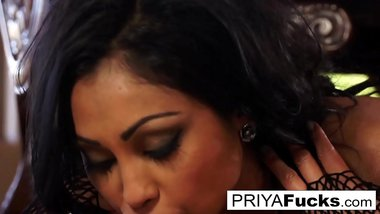 Indian MILF Priya Rai slobbers all over a giant black dildo