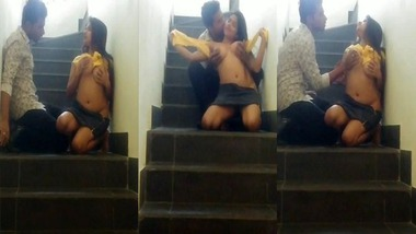 Horny booby girl sex on staircase captured on cam