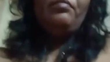 Desi mom with serious face sits before camera topless in solo sex clip