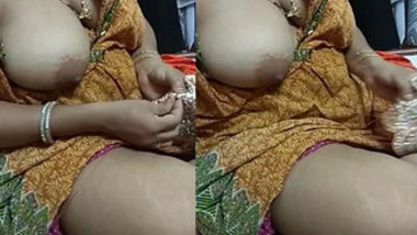 Indian MILF enjoys embroidering with a breast out in homemade porn clip
