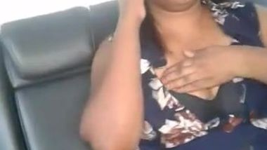 Whorish desi mom talks on phone and touches own big breasts in taxi
